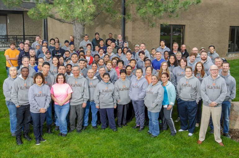 Employees gathered outside in KAHIKI® Hoodies
